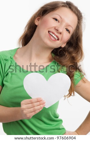 Dynamic young woman with a white heart in her hand - stock photo