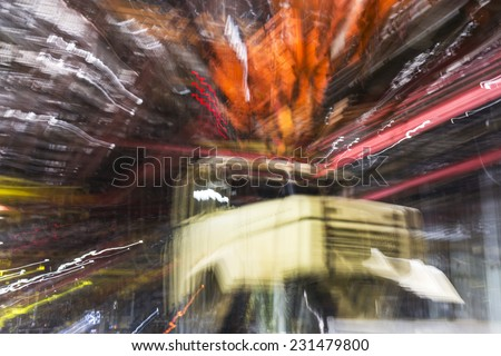 Dynamic zoom blur of cabin on heavy trucks motor plant, Ukraine - stock photo