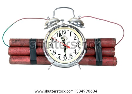 Dynamite Bomb with a clock set to explode at 6:00 - stock photo