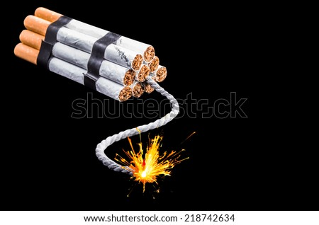 Dynamite composed of cigarettes with burning wick isolated on black background with clipping path - stock photo