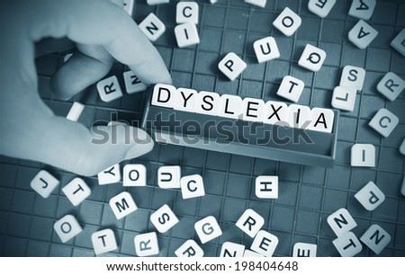 Dyslexia concept with game board and random letters - stock photo