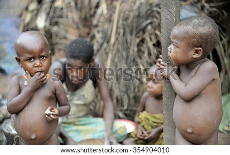 DZANGA-SANHA FOREST RESERVE, CENTRAL-AFRICAN REPUBLIC (CAR), AFRICA - NOVEMBER 5, 2008: Portrait of a child from a Baka tribe of pygmies. Jungle of CAR. Africa. Jungle of the Central-African Republic  - stock photo