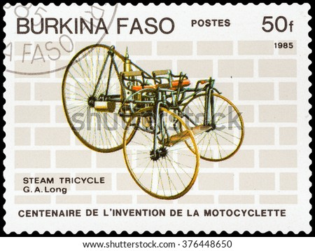 DZERZHINSK, RUSSIA - FEBRUARY 04, 2016: A postage stamp of BURKINA FASO shows vintage motorcycle, Stem Tricycle, G.A. Long, circa 1985 - stock photo