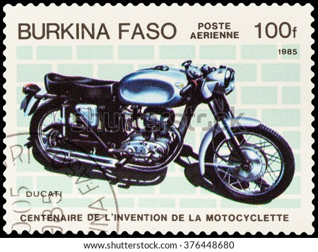 DZERZHINSK, RUSSIA - FEBRUARY 04, 2016: A postage stamp of BURKINA FASO shows vintage motorcycle, Ducati, circa 1985 - stock photo
