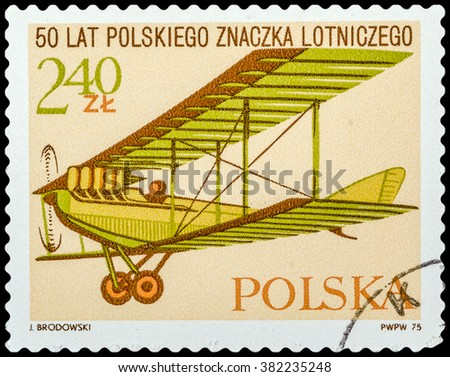 DZERZHINSK, RUSSIA - FEBRUARY 11, 2016: A postage stamp of POLAND shows vintage airplane, devoted to 50 years of Polish flight sign, circa 1975 - stock photo