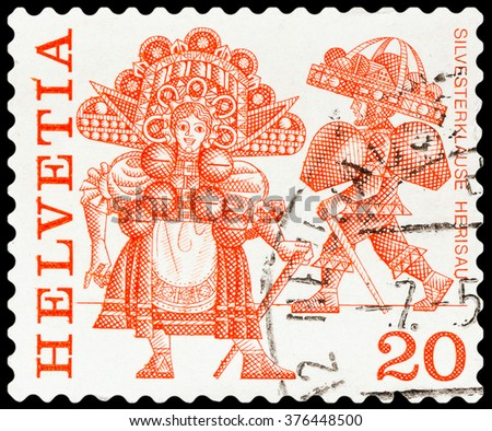 "DZERZHINSK, RUSSIA - FEBRUARY 04, 2016: A postage stamp of SWITZERLAND shows Regional Folk Customs with inscriptions ""Silvesterklause, Herisau"", circa 1977 - stock photo"