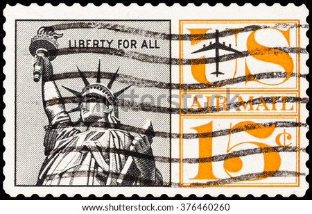 DZERZHINSK, RUSSIA - FEBRUARY 04, 2016: A postage stamp of USA shows Airmail Postage, Statue of Liberty, circa 1961 - stock photo
