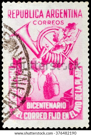 DZERZHINSK, RUSSIA - JANUARY 18, 2016: A postage stamp of ARGENTINA shows postal horn, circa 1939 - stock photo