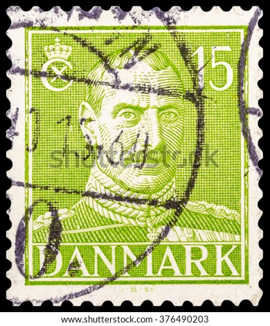 DZERZHINSK, RUSSIA - JANUARY 18, 2016: A postage stamp of DENMARK shows portrait of King Christian X, circa 1942