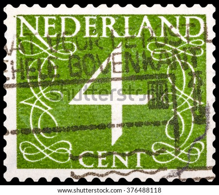 DZERZHINSK, RUSSIA - JANUARY 18, 2016: A postage stamp of NETHERLANDS shows numeric value 4 cent, circa 1955 - stock photo