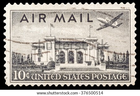 DZERZHINSK, RUSSIA - JANUARY 18, 2016: A postage stamp of USA shows image a Martin 202 plane over Pan American Union Building, Washington DC, circa 1947