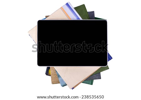 E-book lies on a pile of books - stock photo