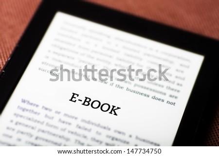 E-book on ebook, tablet pc concept - stock photo