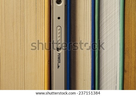 E-book paper books among - stock photo