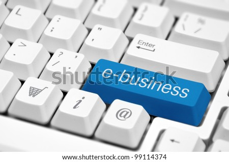 e-business key on a white keyboard closeup. E-commerce concept image. - stock photo