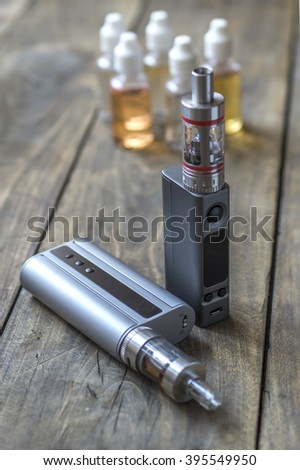 e-cigarettes with lots of different re-fill bottles, close up - stock photo