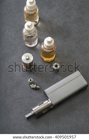 e-cigarettes with lots of different re-fill bottles, from above