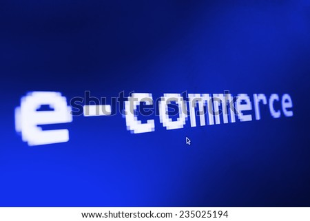 E-commerce big title on computer screen and mouse cursor and mouse pointer. Blue background color. Vignette light and dark shadow dramatic effect.  - stock photo
