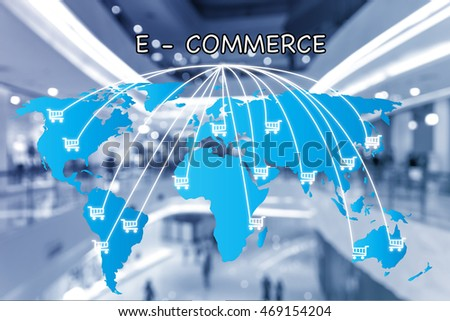 E-commerce business and global network connection and cart sign with shopping mall in background. E-commerce business network connection concept.(Elements of this image furnished by NASA)