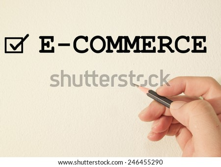 E-commerce check mark on wall background  - stock photo