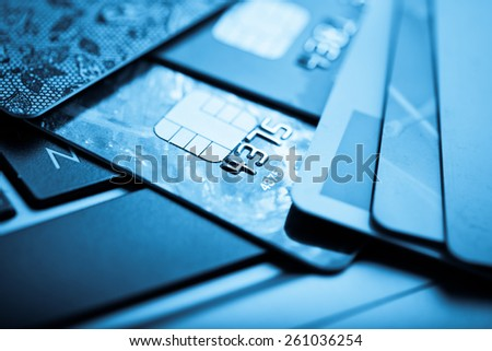 E-commerce concept. group of credit cards and laptop with shallow DOF