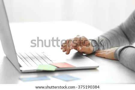 E-commerce concept. Woman with credit card and laptop, close up - stock photo