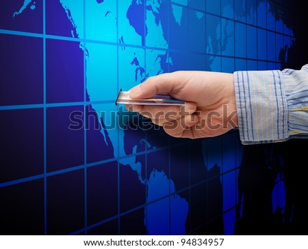 E-Commerce: Mans Hand With Credit Card and Map of World - stock photo