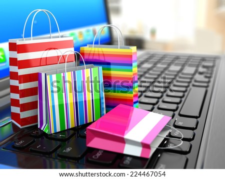 E-commerce. Online internet shopping. Laptop and shopping bags. 3d - stock photo