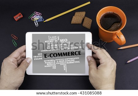 E - Commerce word cloud. Text on tablet device  - stock photo