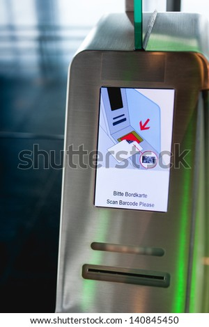 E-gate smart access (boarding pass scanners) displaying inviting to scan the boarding pass at the immigration checkpoint on arrival or departure in a modern airport - stock photo