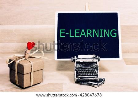 e-learing written on a chalkboard - stock photo