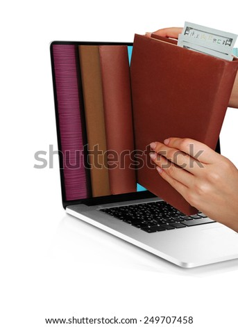 E-learning concept.  Digital library - books inside laptop isolated on white - stock photo