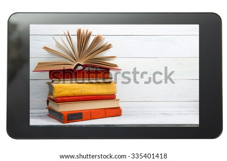 E-learning concept. Digital library - books inside tablet pc. Copy space for text - stock photo
