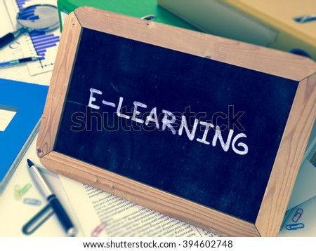 E-learning Concept Hand Drawn on Chalkboard on Working Table Background. Blurred Background. Toned Image. 3D Render. - stock photo