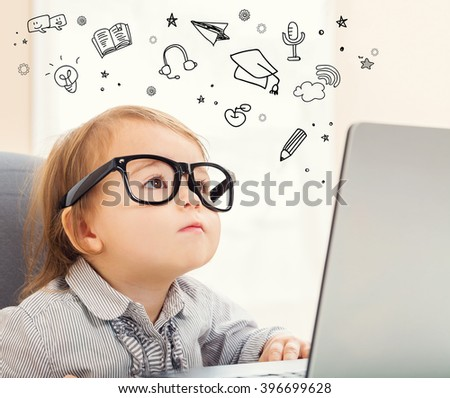 E Learning concept with toddler girl using her laptop - stock photo