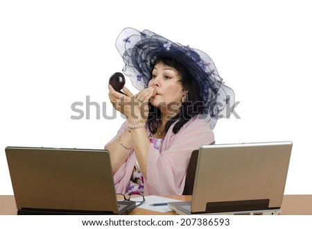 E-learning mature teacher powdering her face in front of two laptops. Portrait of businesswoman on white background