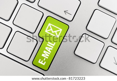 E-mail key concept. Button on modern aluminum keyboard.