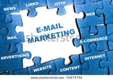 E-mail marketing blue puzzle pieces - stock photo