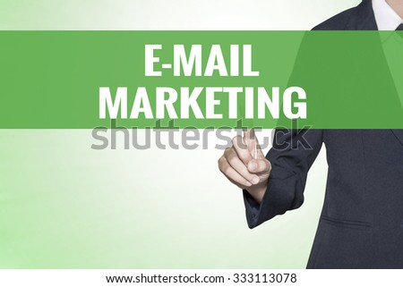 E-Mail Marketing word on green virtual screen touching by business woman - stock photo