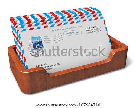 E-mail, messaging and communication concept: wooden office desktop box with letters of incoming correspondence isolated on white background - stock photo