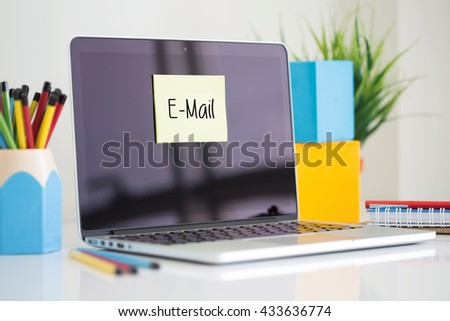 E-Mail sticky note pasted on the laptop - stock photo