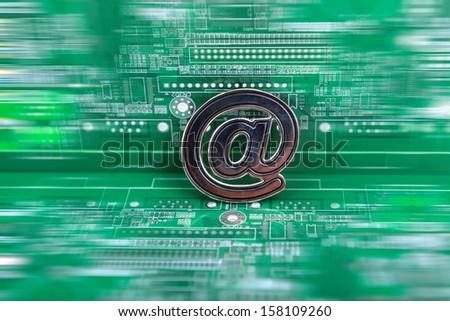 E-mail symbol on circuit board - stock photo