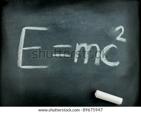 E=mc²  Albert Einsteins physical formula on blackboard - stock photo