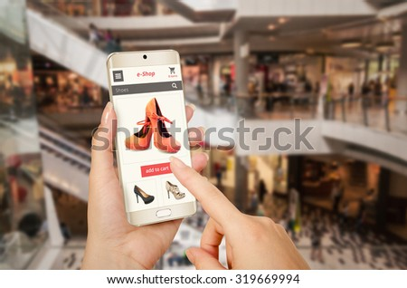 e shopping with smart phone in woman hand
