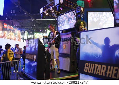 E3; The Electronic Entertainment Expo at the Los Angeles Convention Center, June 16, 2015. Los Angeles, California. The Guitar Hero game demo allowed players to become rock stars for a while.
