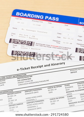 E-ticket and boarding pass; e-ticket and boarding pass are mock-up - stock photo