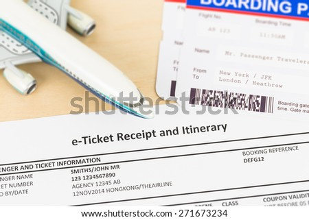 E-ticket with plane model, and boarding pass; these documents are mock-up