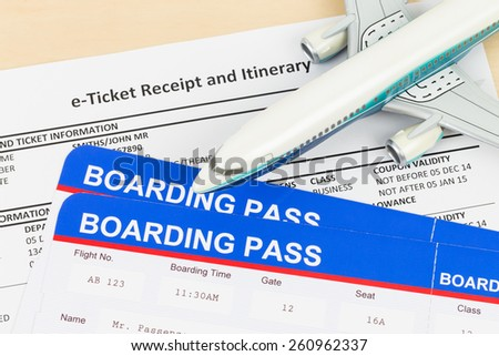 E-ticket with plane model, and boarding pass; ticket and boarding pass are mock-up