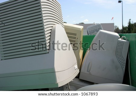 e-Waste (old computers and electronics) being recycled - stock photo