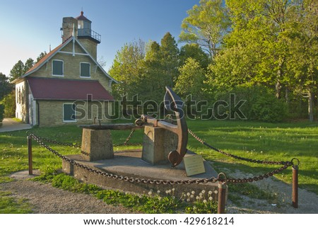 Eagle Bluff Lighthouse is located in Peninsula State Park in Door County, Wisconsin, and shown here in late light in Spring - stock photo